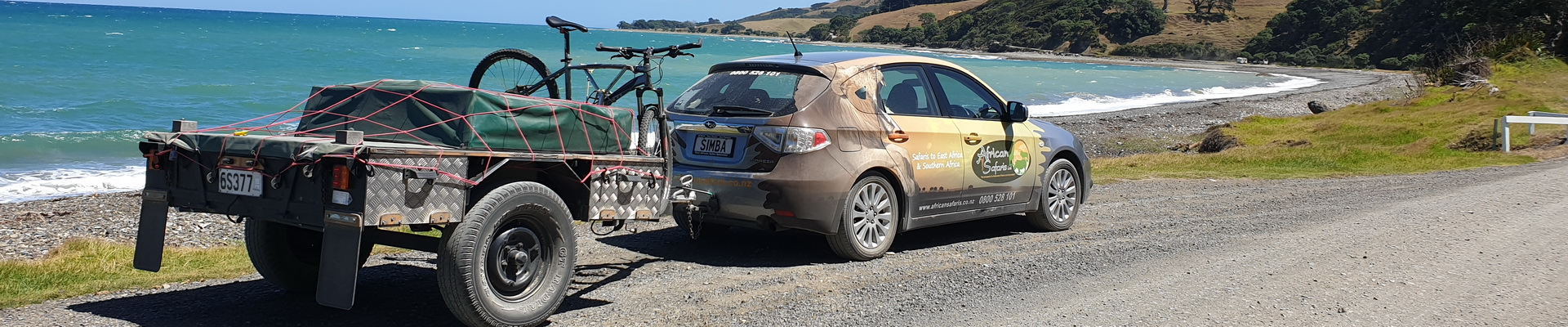 Simba and KiwiFlyer on the road to Fletchers Bay, Coromandel Peninsula
