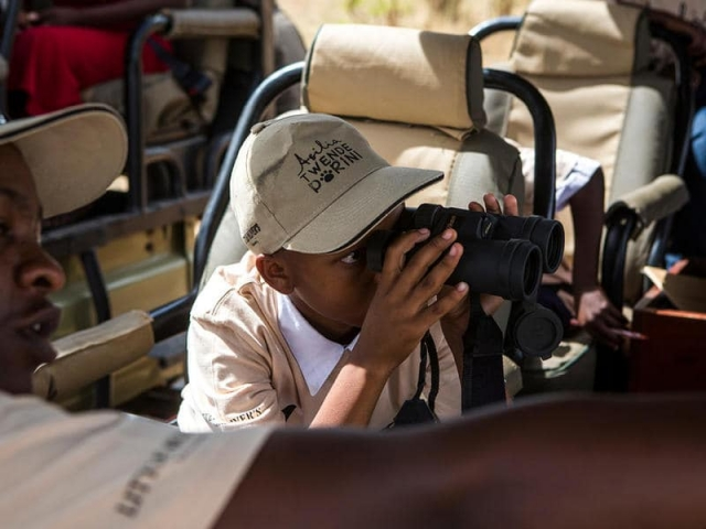 Guide using binoculars