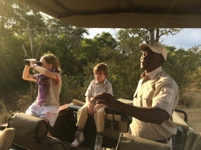 Guide and children from Asura Selous Camp, Tanzania